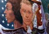 three faces depict the various ethnicities of Americans, flanked by the American flag and a bald eagle