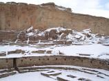 Great Kiva in west plaza of Pueblo Bonito in snow