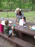 Park Ranger Natasha Moore working with a young visitor on Junior Ranger Day activities.