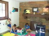 Children working on craft activities inside the Junior Ranger Station.