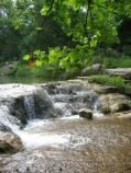 View of a waterfall along Travertine Creek.