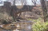 Built in 1909, the Lincoln Bridge is built in a Gothic Revival style, and provides foot access across Travertine Creek.