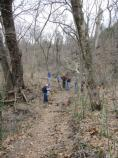 Volunteers gather along the trail at one of the worksites.