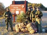 rangers at montezuma pass with a bales of illegal drugs
