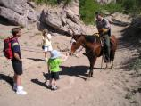 Ranger on horse patrol stops to talk with hikers