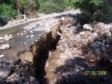 Flood waters scoured out a 5 foot deep trench as it tried to reach Montezuma Wash.