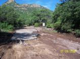 Flood waters washed away section of the pavement on Montezuma Canyon Rd.