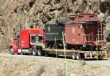 Trailers are hauled through the canyon to the maintenance yard.
