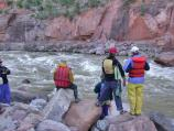Scouting Warm Springs, a rapid on the Yampa River