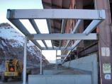 The steel framework for the entrance ramp, seen from underneath the end of the ramp at what will be the future entrance to the building.