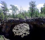 A huge lava bridge spans a deep channel in the Big Tubes area.
