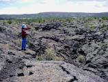 A hiker takes in the panorama of the McCartys Lava Flow.
