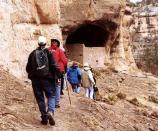 Visitors approaching the entrance of Cave 3