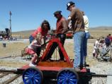 Visitors get an opportunity to ride on the pushcart as part of the Railroaders Festival celebration.