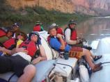 High School aged participants on an Unearthed program relaxing on a boat in the Colorado River.
