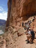 Unearthed participants hanging out by Nankoweap granaries inside Grand Canyon.
