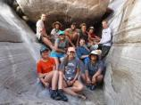 Group shot of Grand Canyon Unearthed Participants in the Muav Gorge of Grand Canyon.