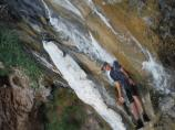 Participant on Artist as Ambassadors cooling of in a small waterfall in Grand Canyon.