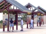 D10028 VISITORS TO GRAND CANYON NP. VIEWING INFORMATIONAL DISPLAYS AT CANYON VIEW PLAZA. NPS PHOTO.