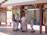 D10026 VISITORS TO GRAND CANYON NP VIEWING INFORMATIONAL DISPLAYS AT CANYON VIEW PLAZA. NPS PHOTO
