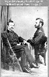 17226 JOHN W.POWELL (RIGHT, AGE 31) & BROTHER WILLIAM, SEATED, IN CIVIL WAR UNIFORMS. GRCA 13846. CIRCA 1865.