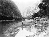 17239 2ND POWELL EXPEDITION. DELLENBAUGH SEATED & REFLECTED IN GREEN RIVER. LADORE CANYON. GRCA 14773. MAY 1871.