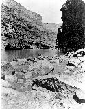 17247 BOATS OF POWELL'S SECOND EXPEDITION IN MARBLE CANYON. ARMCHAIR AND LIFE PRESERVERS. CIRCA 1872.