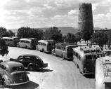 FRED HARVEY TOUR BUSSES PARKED IN FRONT OF THE DESERT VIEW WATCHTOWER. CIRCA 1938 NPS.