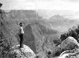 Uniformed Park Ranger, Tex Worley, looks into the Grand Canyon from Arapahoe Point, West of Cape Royal on the North Rim. 05754