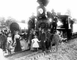 The arrival of the first train to carry passengers all the way to the Grand Canyon Village. The participants pose in front of the locomotive.