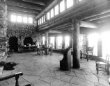 INTERIOR OF HERMITS REST LIVING ROOM LOOKING NORTHWEST WINDOWS AND DOORS OF MAIN ENTRANCE FEATURED. CIRCA 1916, GRCA 22646. SANTA FE RR PHOTO.