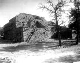 EXTERIOR VIEW OF HOPI HOUSE WITH LADDERS. METATES LEANING AGAINST BUILDING. GRCA 27532 CIRCA 1906