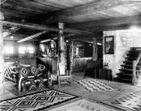 LOOKOUT STUDIO. INTERIOR WITH COUCH, NAVAJO RUGS, STAIRWAY AND SALES AREA. GRCA 50632. CIRCA 1915. SANTA FE RR PHOTO