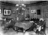 Conrad Kohrs and his friends in the sitting room of the main ranch house.