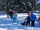 Ranger leading students on a snowshoe hike