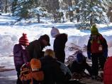 Ranger and students with snowshoes at visitor center