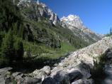 View of Cascade Canyon and trail with Cathedral Group in background.