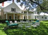 Lawn Chairs sit under the live oak tree in the front yard of the Texas White House.