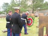 Marines laying a wreath for fallen comrades on the field of empty chairs, during the anniversary.