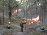 Woman working on fireline during prescribed fire