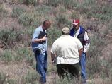 A University of Montana researcher works with a NPS Natural Resource Specialist and a Southern Arapaho tribal member.