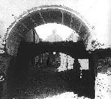 arched entryway to church with interior roof missing