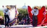 folklorico dancers on stage with dome in background