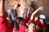 ranger and students pointing inside the mission church