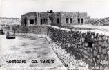 Postcard taken of the completed visitors' center in the 1930s. After excavation and reconstruction of the ruins the crew built the visitors center and museum in the style of the pueblo at Tuzigoot.