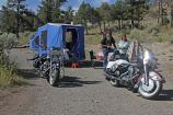 Two campers, motorcycles and portable tent at the Mammoth Campground.