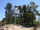 The Chequamegon Point Lighthouse at the west end of Long Island is one of two beacons that helped to guide vessels around Long Island into Chequamegon Bay on their way to Ashland.