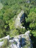 color photo of narrow ridge of gray limestone bluff with forest on either side