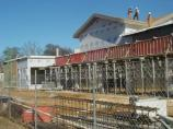 Workers begin adding roof to clerestory of new visitor center, 1/30/07.