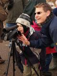 A boy observes the herons at the Bath Rd Heronry using a spotting scope